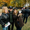 "Linda Person-Gauthier, veteran John Person and Jackie Gauthier pause for a photo at Carter Park during the final day of ""The Wall That Heals"" in Leominster on Saturday afternoon. SENTINEL & ENTERPRISE / Ashley Green"