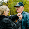 """Army Veteran Glenn Dawson receives a Vietnam Veteran pin at Carter Park during the final day of """"The Wall That Heals"""" in Leominster on Saturday afternoon. SENTINEL & ENTERPRISE / Ashley Green"""