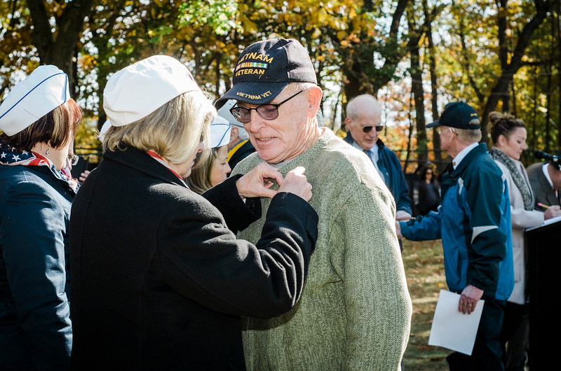 """Frank Norman Jr.  receives a Leominster Vietnam Veteran Medal at Carter Park during the final day of """"The Wall That Heals"""" in Leominster on Saturday afternoon. SENTINEL & ENTERPRISE / Ashley Green"""