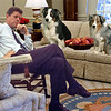 President Barack Obama walks into the Oval Office at the White House Wednesday morning, Jan. 21, 2009, for his first full day in office. His Personal Aide Reggie Love stands nearby.  <br /> Official White House photo by Pete Souza