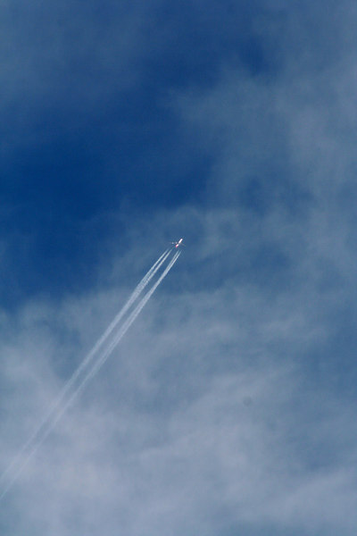 Aircraft with contrail over Reids Flat, New South Wales.