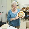 JOAN N. WITH HER FARM SCENE CARVED PLATE.