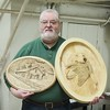 CLUB PRESIDENT CLARK A. WITH HIS CARVINGS FOR A STIFEL EARTH-WOOD-FIRE PROJECT