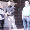 SUE M. TREASURER  HANDS CHECK OF $2800 TO RICK M. WITH PRESIDENT CLARK A. OBSERVING.