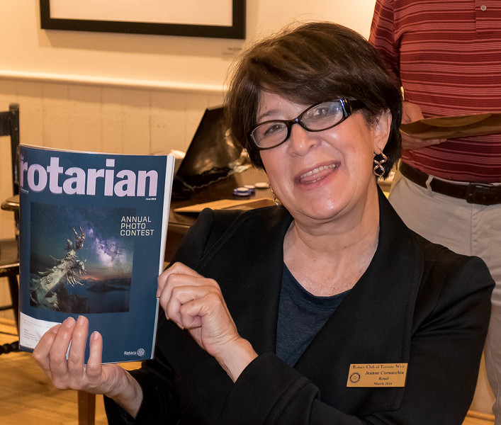 Jeanne displays the latest ROTARIAN magazine, this issue containing photos from around the world for the Annual Photo contest. This magazine is filled with inspiring stories contributed from some of the 32,000  Rotary Clubs Worldwide.
