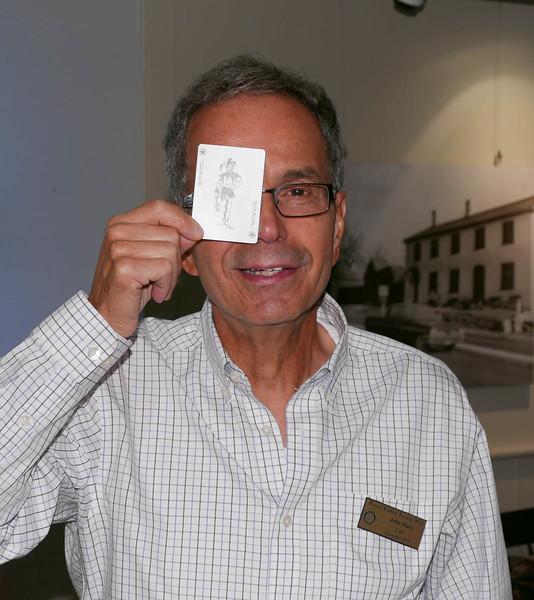 Rotarian John Muto picks the elusive Joker card and wins half of the Happy Bucks pot!