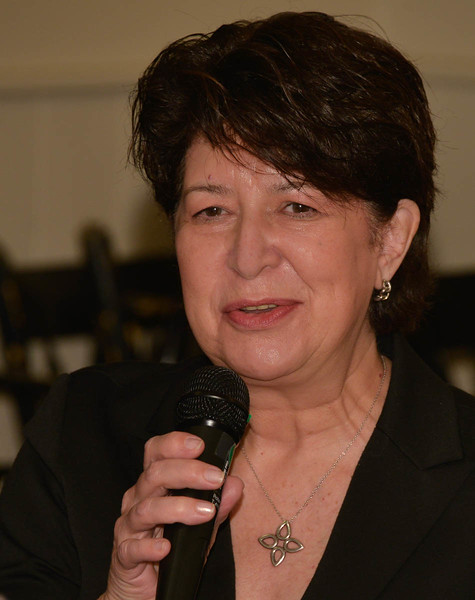 """New club member Jeanne Cornacchia says a few words at our """"Happy Buck"""" time."""