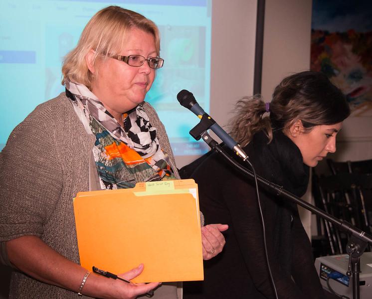 "Patti explains the importance of ""World Toilet Day"" while Salomeh preps her slideshow explaining the impact of poor sanitation around the world."