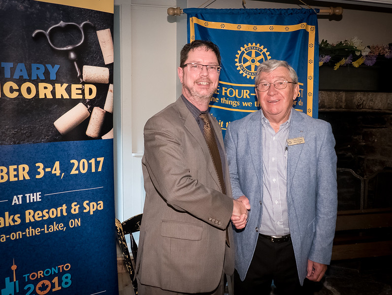 District Governor Neil Phillips is welcomed by RTW President Terry Donohue