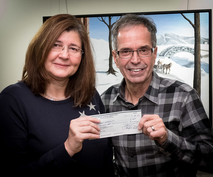 John presented Maria with a donation for her project
