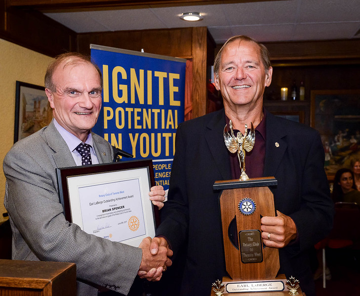 Finally, Leighton Reid presented past president Brian Spencer with the Earle LaBerge trophy given annually to a Club Member who exemplifies the spirit of Rotary through outstanding contribution to the activities and goals of the Club.