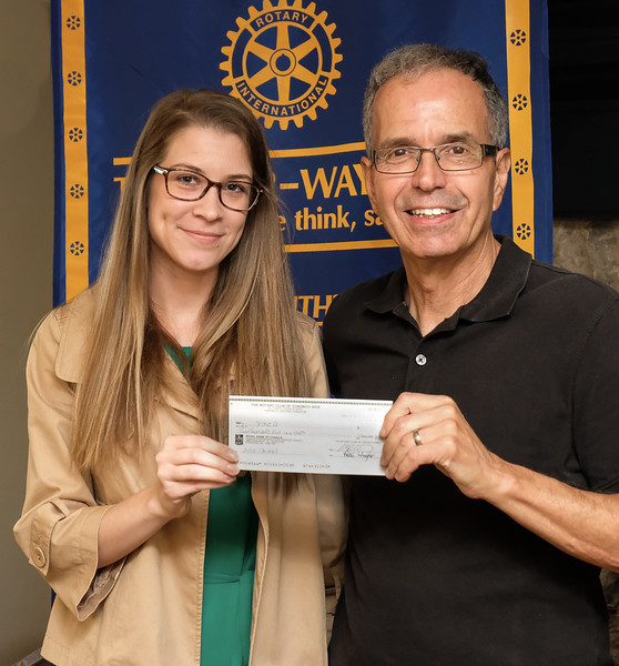 John Muto presented Taylor with a cheque in support of the YMCA summer camp programs.