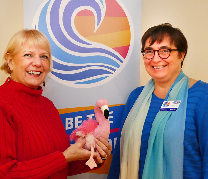 Past President Susan McCoy  with the Flamingo of Change.  Sue had spoken of the many community projects our club has been engaged in.