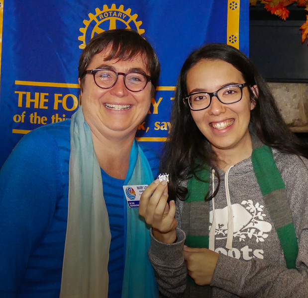 """New member Sarah  D'Aversa was presented with a """"Women In Rotary""""  pin"""
