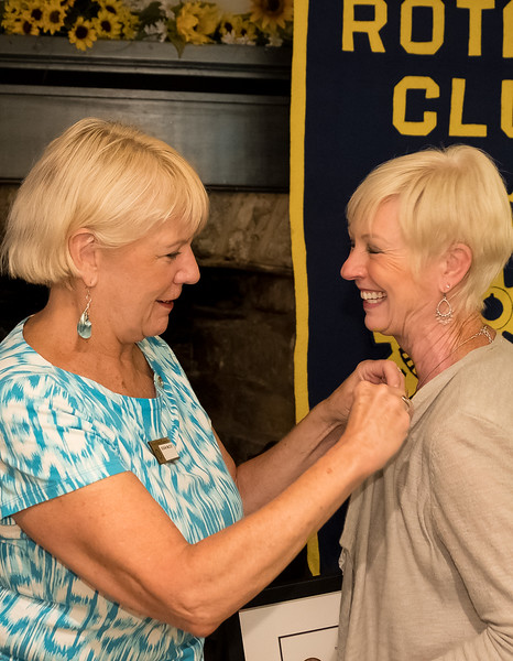 Susan McCoy presents Janet with the Paul Harris pin