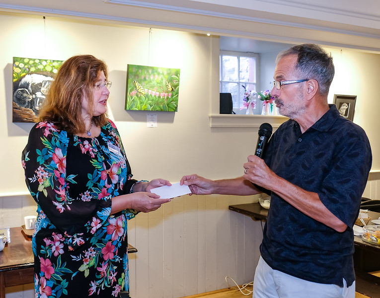 RTW Director  John Muto presented Maria with a donation to her organisation in support of the many continuing efforts and achievements in making a big difference to thousands of young girls in many countries.
