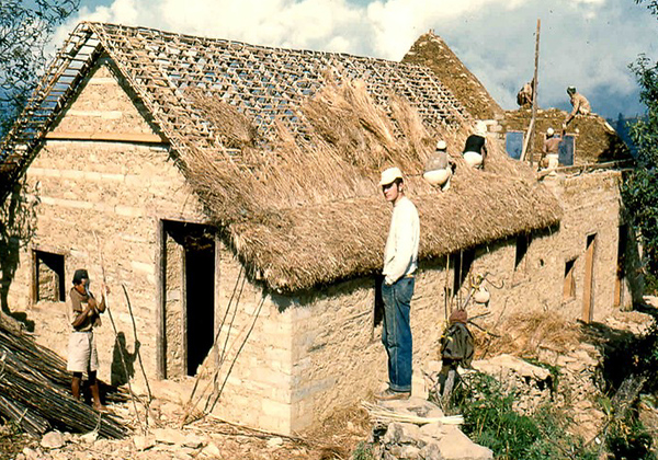 One of my colleagues was stationed with this project to oversee construction. Local labour was always used. Here their skills were needed to install a thatched roof.