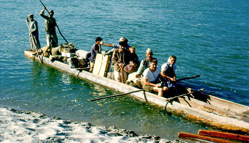 We had several river crossings and used ferries such as this one. It was two dug out canoes lashed together. The oarsmen guided the craft through the river current to the other side.