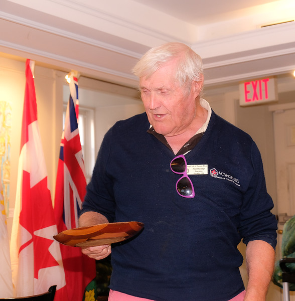 Member John Hastings giving a happy buck for the RTW collection plate.
