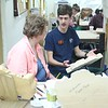 Ann asking Dylan questions regarding deep relief carving work