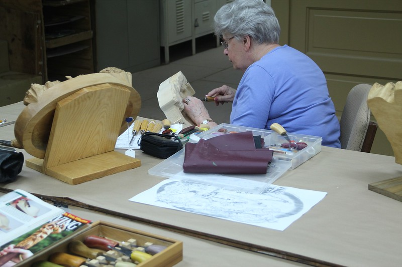Joan hard at work on a relief
