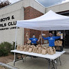 Staff members Kara Danas of Lowell and Louis Casiano of Lawrence are ready to give out meals.