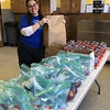 Program Director Alisha Harrison of Milford packs a bag with a smile.