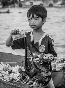 Young man selling bananas