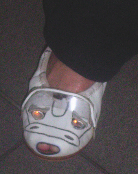 Very clever shoes -- headlights & all .... we do have some real enthusiasts in the Clubs ...