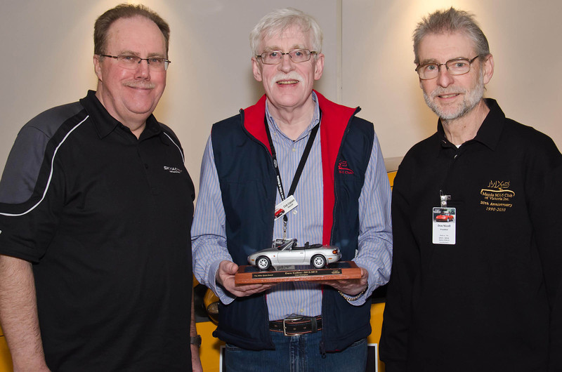 Mazda Australia MD Martin Benders (left) and Club president Don Nicoll present Dave Collins with the Club Champion award
