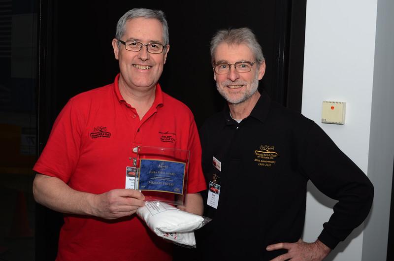 "Murray Finlay accepts the 2013-2014 ""Jinba Ittai"" award from Don Nicoll"