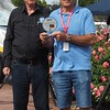 """Lori Mercieca shows off his trophy for """"Best Japanese Open Sports Car"""""""