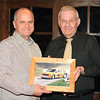 John Bogie being presented with a small token of thanks from club Chairman, George Rutherford. The photo was taken by Barry Lindsay and was the club magazine cover photo for February 2012.