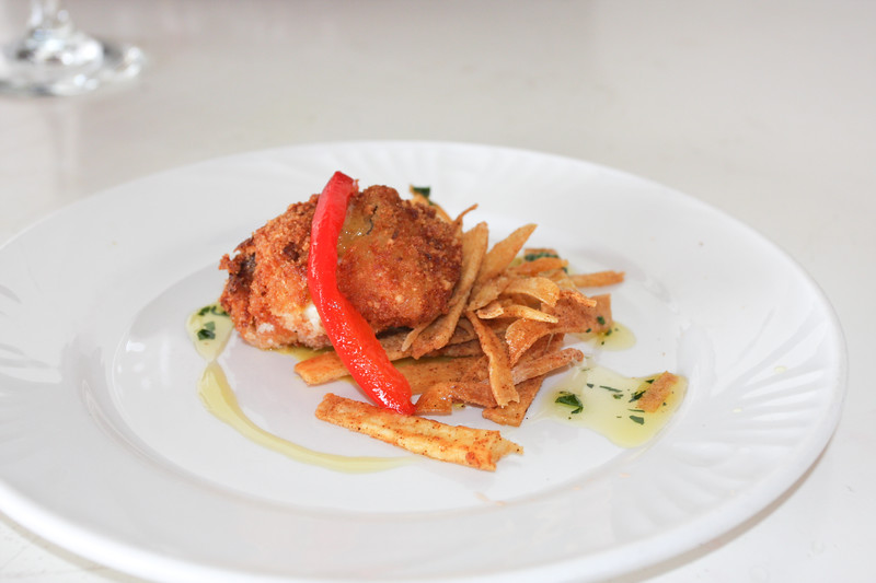 Cashew Crusted Red Snapper with Yucca Fritter, and Shrimp Saffron Sauce.