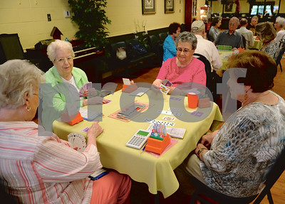 Members of the Bridge Club practice their craft at the Tyler Senior Center.  (Victor Texcucano/Staff)