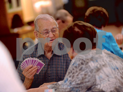 Ed Stewart and Miriam Robin of the Tyler Senior Center Bridge Club socialize before starting a new game on May 21. (Victor Texcucano/Staff)
