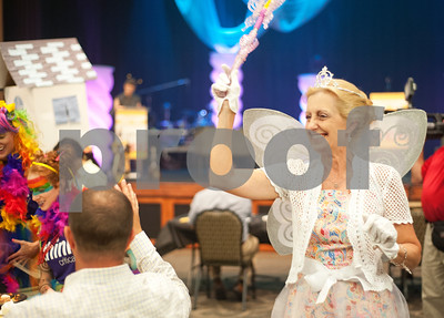 "photo by Sarah A. Miller/Tyler Morning Telegraph  Connie Moore of team Mentoring Minds greets audience members while dressed as Glenda the Good Witch from ""The Wizard of Oz"" during the 23rd Annual Literacy Council of Tyler Corporate Spelling Bee Tuesday Aug. 5, 2014 at Green Acres Crosswalk Center in Tyler, Texas. The spelling bee raised $67,000 for the non-profit organization that provides educational services to East Texans."