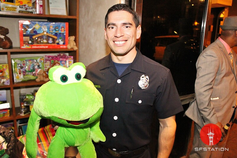 """Photo by Mark Portillo<br /><br /><a href=""""http://www.sfstation.com/yuppie-friday-happy-hour-supports-sf-firefighters-toy-drive-e1431991"""">http://www.sfstation.com/yuppie-friday-happy-hour-supports-sf-firefighters-toy-drive-e1431991</a>"""