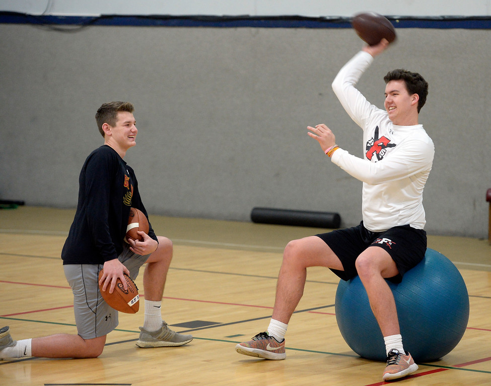 . LONGMONT, CO: February 16, 2019:  Skyline quarterback Chase Silva and Fairview quarterback Aidan Atkinson work on passing during the training session. Skyline quarterback Chase Silva and Fairview quarterback Aidan Atkinson met with coach Warren McCarty for a regular training session in Longmont. Warren McCarty has been a private football personal trainer and coach that has impacted the lives and athletic careers of dozens of the top players from the Boulder County area. He is a Longmont resident and specializes in quarterbacks (he was one), but also runs a recruiting business that is based on the relationships be built during his 10-year career in pro football, as well as representing collegiate and professional football coaches as an agent. (Photo by Cliff Grassmick/Staff Photographer)