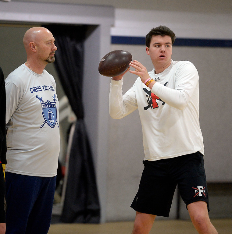 . LONGMONT, CO: February 16, 2019: Fairview quarterback Aidan Atkinson works out at the training session as Warren McCarty watches. Skyline quarterback Chase Silva and Fairview quarterback Aidan Atkinson met with coach Warren McCarty for a regular training session in Longmont. Warren McCarty has been a private football personal trainer and coach that has impacted the lives and athletic careers of dozens of the top players from the Boulder County area. He is a Longmont resident and specializes in quarterbacks (he was one), but also runs a recruiting business that is based on the relationships be built during his 10-year career in pro football, as well as representing collegiate and professional football coaches as an agent. (Photo by Cliff Grassmick/Staff Photographer)