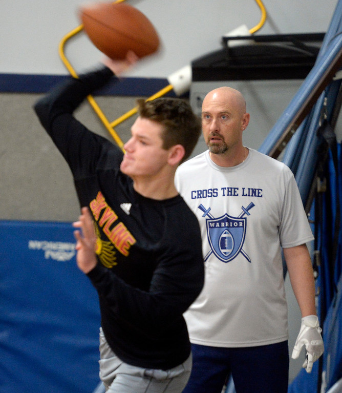 . LONGMONT, CO: February 16, 2019: Warren McCarty watches Chase Silva throw during the training session. Skyline quarterback Chase Silva and Fairview quarterback Aidan Atkinson met with coach Warren McCarty for a regular training session in Longmont. Warren McCarty has been a private football personal trainer and coach that has impacted the lives and athletic careers of dozens of the top players from the Boulder County area. He is a Longmont resident and specializes in quarterbacks (he was one), but also runs a recruiting business that is based on the relationships be built during his 10-year career in pro football, as well as representing collegiate and professional football coaches as an agent. (Photo by Cliff Grassmick/Staff Photographer)