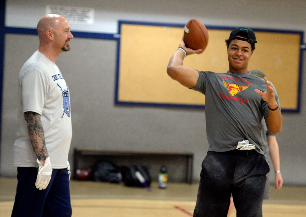 . LONGMONT, CO: February 16, 2019: Warren McCarty visits with Skyline RB, Jeremy Hollingsworth. Skyline quarterback Chase Silva and Fairview quarterback Aidan Atkinson met with coach Warren McCarty for a regular training session in Longmont. Warren McCarty has been a private football personal trainer and coach that has impacted the lives and athletic careers of dozens of the top players from the Boulder County area. He is a Longmont resident and specializes in quarterbacks (he was one), but also runs a recruiting business that is based on the relationships be built during his 10-year career in pro football, as well as representing collegiate and professional football coaches as an agent. (Photo by Cliff Grassmick/Staff Photographer)