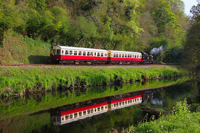 228 heads nroth along the River Dart on the South Devon Railway 22/04/11