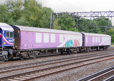 6377 - EMU Barrier Vehicle, painted in Porterbrook Purple heads north past South Kenton Tube Station. 6376 was converted from Mk1 RUO 1042. 10/09/09
