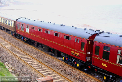 """99316 heads west through Dawlish on the: 1Z83 14:50 Exeter St Davids to Truro """"The Great Britain VII"""" 26/04/14  99316 was converted from Mk1 FK 13321 by the conversion of compartments into a kitchen area. Two former first class compartments retained for staff use. The original corridor remains, on the other side of this photo"""