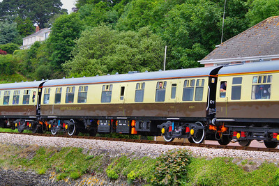 Mk1 RBR 1671 wearing a fresh coat of Chocolate & Cream livery arrives into Kingswear passing the Royal Britannia Crossing 05/06/11