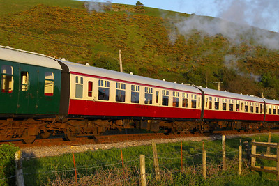 Mk1 TSO 4055 passes Corfe Castle Foot Crossing on the Swanage Railway Dining Set. The interior has been configured to a lounge car.  11/05/12