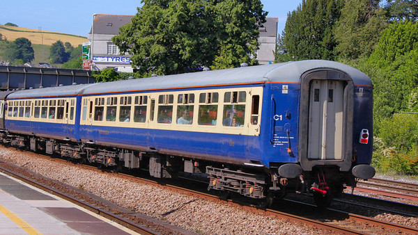 Mk2a TSO 5292 heads west through Totnes, wearing Riviera Trains Blue & Cream 26/06/10  5292 was repainted into Carmine & Cream in 2010