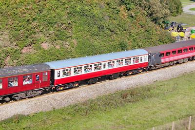 Mk2a TSO 5292 in ex-works Carmine & Cream heads west onto the Dawlish Sea Wall passing Langstone Rock 25/09/10  5292 was originally in Riviera Trains Blue & Cream