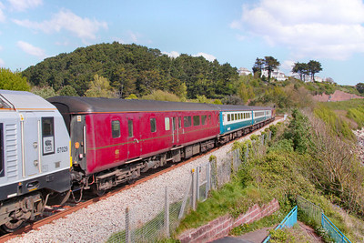Mk2d BSO 9494 heads south past Hollicombe Gas Works, wearing EWS charter maroon livery 04/05/10
